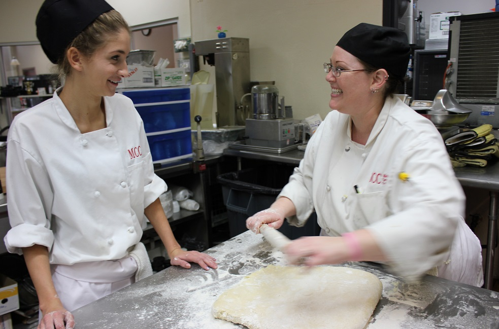 Female students preparing pastry