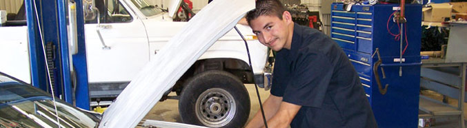 Student working on a vehicle.